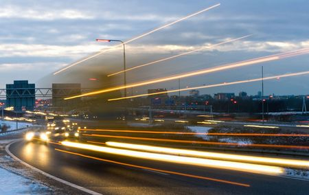 junction: Truck passing by on a motorway junction on a winter evening Stock Photo