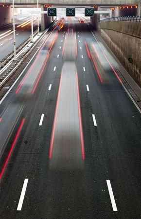 Busy traffic on a motorway with a speed limitation ahead photo