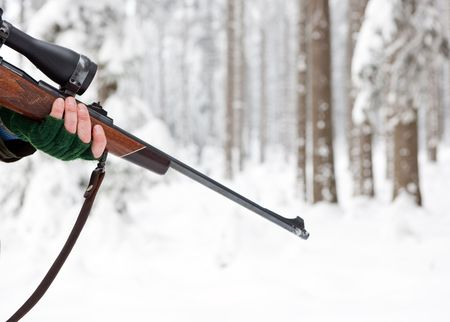 hunting rifle: Hand of a Hunter, holding a rifle in a winter forest
