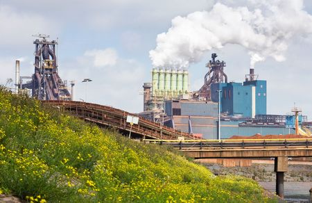 Steel works on a hot summer day. Heat emerges from the plant,  photo
