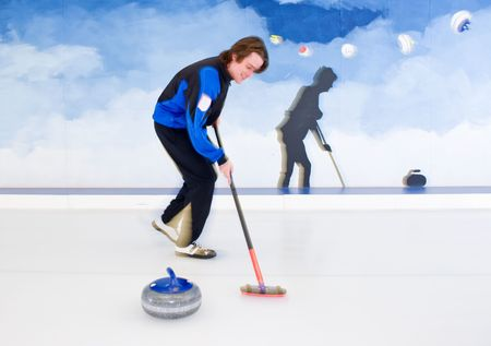 curvature: Curling player influencing the curvature of a stone being delivered with his broom