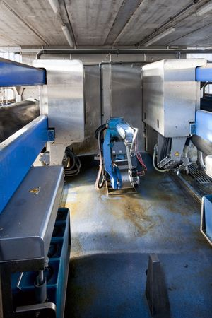cattle wires: Milking robot interior, with two parallel bays to milk the cows in a dairy farm
