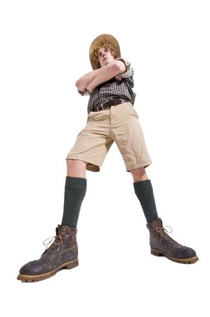 dauntless: A dauntless boyscout, dressed in joungle outfit with his arms crossed Stock Photo