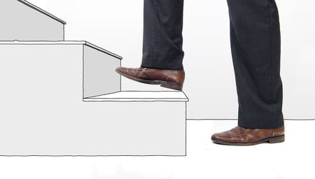 Conceptual image of a business moving up and making a carreer, represented by the feet of a businessman walking up an imaginary staircase, one step at a time. Stock Photo - 6492288