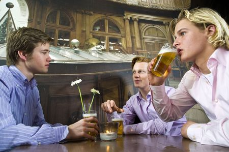 three young men drinking beer in a bar photo