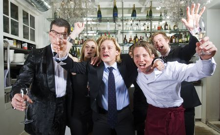 Group of friends cheering in a restaurant bar photo