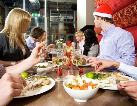 Group of friends enjoying their christmas dinner in a restaurant