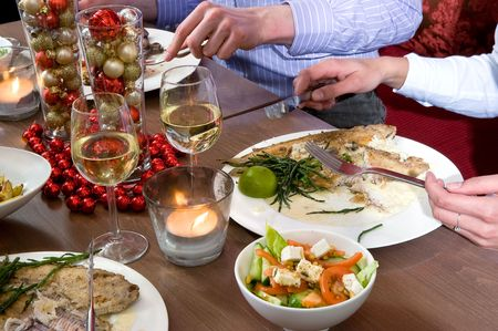 restaurant industry: Group of friends enjoying their christmas dinner in a restaurant
