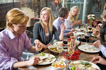 dining: Group of people enjoying a rich dinner in a restaurant