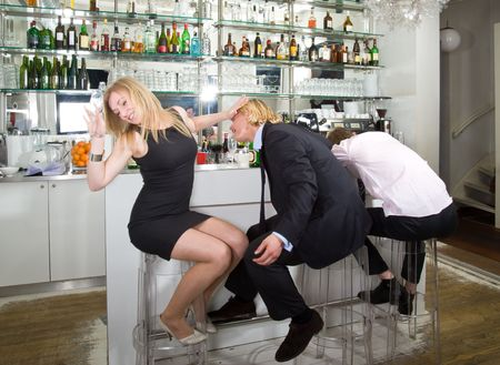 drunks: A young woman turning down a flirting male at a bar with a sleeping drunk next to them Stock Photo