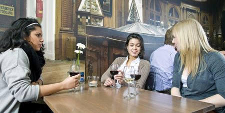 Girl talk at a restaurant table Stock Photo - 6484873