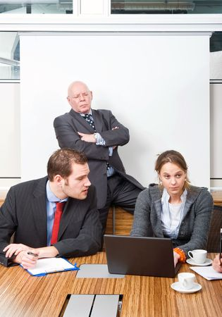 disdain: Boss and businessman looking down in contempt on a secretary for messing up