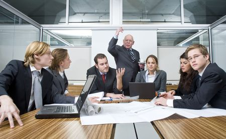 disbelief: The Creative director expresses his disbelief and unhappiness about the work of his young associates during a design brief and business meeting Stock Photo