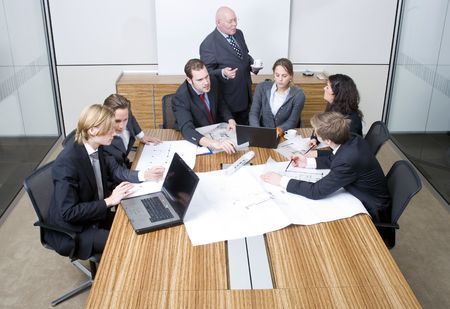 office cubicle: A group of six junior associates during a design team meeting with a senior manager