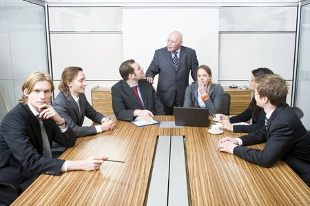 kickoff: A senior manager wishing his associates good luck before the start of a kick-off meeting of an important project Stock Photo