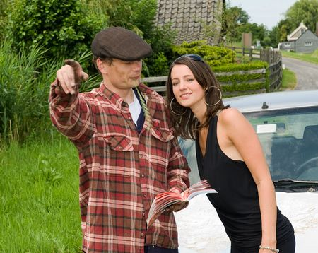 road shoulder: Young, beautiful woman getting directions from a local farmer Stock Photo