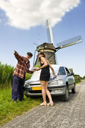 hick: Young woman, lost on a rural road, asking a local farmer for directions