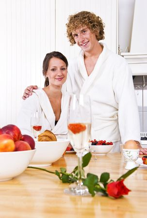 Young couple at a valentines breakfast at the counter in a cosy kitchen photo