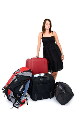 Young smiling woman surrounded by luggage being a happy traveller photo