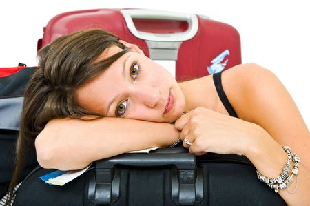 weary: Young woman, resting her head on a suitcase, weary from travelling Stock Photo