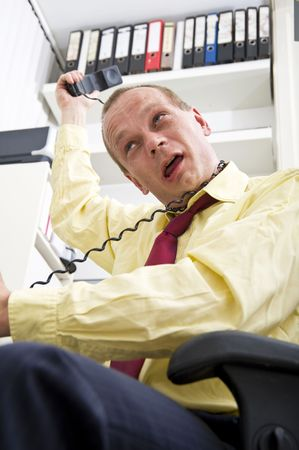 no way out: Businessman, trying to strangle himself with a telephone cord, because of too much stress at work