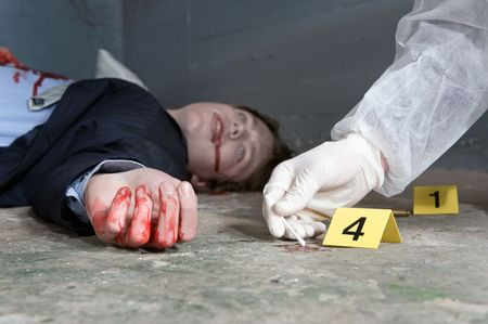 scene of the crime: Forensic expert collecting evidence at the crime scene of a murdered businessman