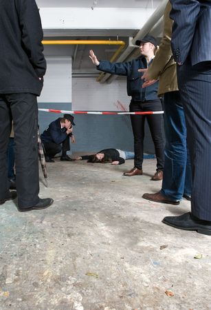 Bystanders looking at a crime scene with a murdered woman photo