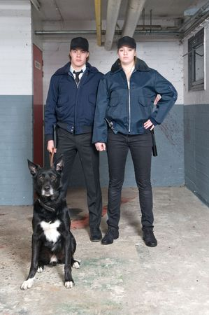squad: Portrait of two young police officers of a k9 squad