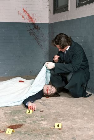 Police inspector examining a dead body, biting on his glasses, deep in thought Stock Photo - 6492669