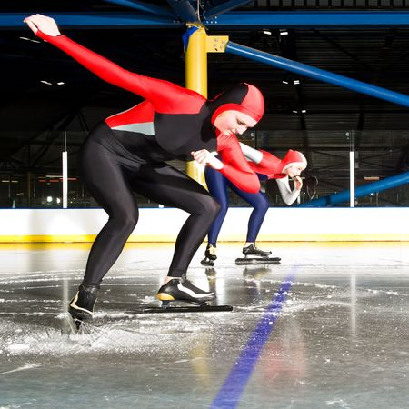ice rink: The start of a womens speed skating race in an indoor ice rink