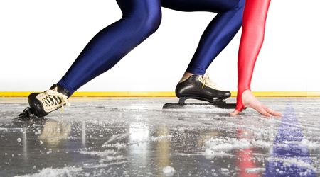 skating rink: Speed skater at the starting line on an indoor ice rink