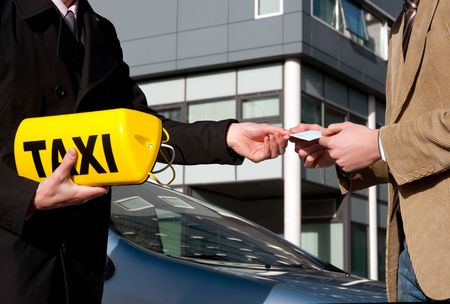 appointed: A government official handing a taxi license and sign to a newly appointed taxi driver