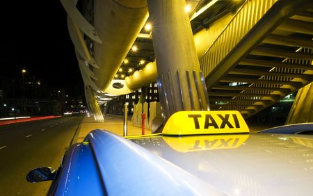 fare: A taxi, waiting for the next fare near the exit of a futuristic public transportation station