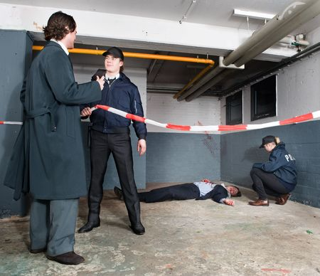 Police inspector identifying himself to a policeman when arriving at a crime scene Stock Photo - 6494283