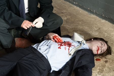 Police inspector hovering over a murdered businessman Stock Photo - 6494295