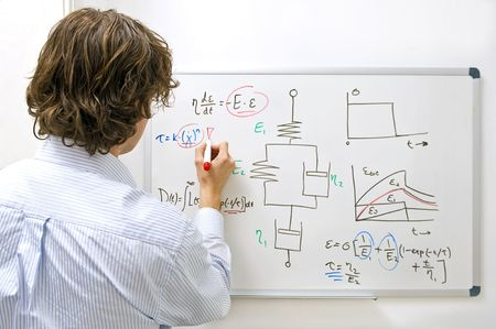 academic dress: An engineer drawing a complexe physics equation on a whiteboard