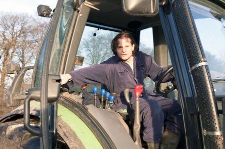 Farmer closing the door of a tractor Stock Photo - 6552734