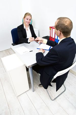 handing over: Two business partners signing a contract and handing over a pen Stock Photo