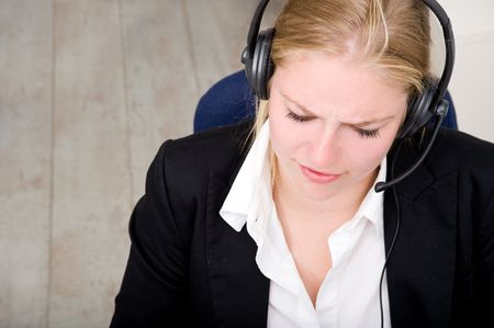 dedicated: A dedicated receptionist at work, using a headset with microphone