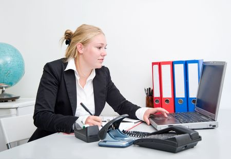 Blond business woman working at the office photo