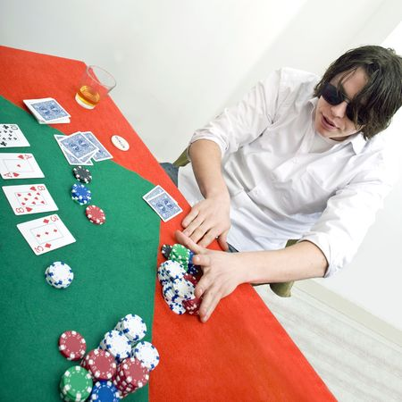 A poker player going all in after the flop Stock Photo - 6553550