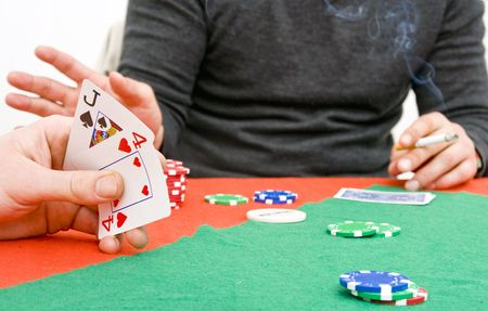 the opponent: Two poker playersduring a game, looking at one hand, and seeing the reaction of the opponent Stock Photo