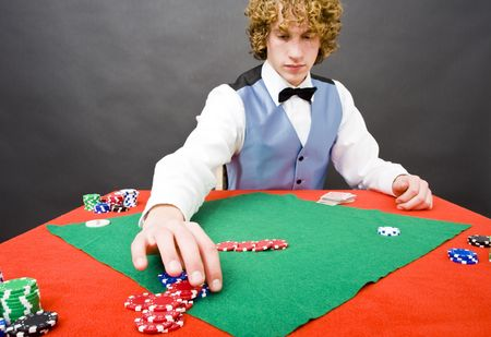 casino dealer: A dealer paying out a player after a winning a game