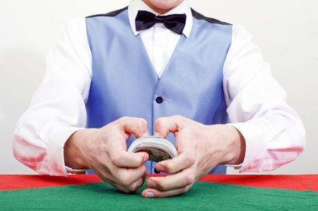 opponents: A dealer shuffling cards at a poker table