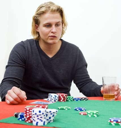 deceitful: A poker player in deep thought to decide the strategy of his game Stock Photo