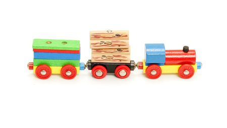 ineffective: Conceptual image of an ineffective process, represented by a toy train with too few carriages and too much blocks to carry. Stock Photo
