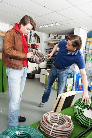 Salesman advising a customer in the garden department of a hardware store Stock Photo - 6726799