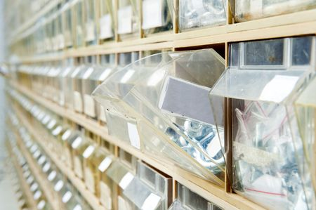 fasteners: Endless rows of hardware in shelves, containing a wide selection of fasteners Stock Photo