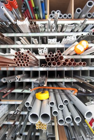 diameters: Long products in a hardware store, including materials for plumbing, flag poles, and different kinds of profiles with a shallow Depth of field Stock Photo
