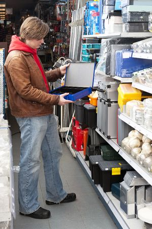 Customer buying a safe deposit box at a hardware store photo